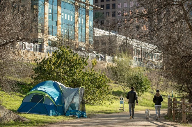 A homeless person's tent along the Ann and Roy Butler Hike and Bike Trail camp in downtown Austin earlier this month.