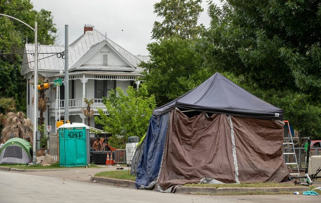 A homeless camp sits along East Cesar Chavez Street. Austin police have not yet started issuing citations for violating the city's reinstated camping ban.