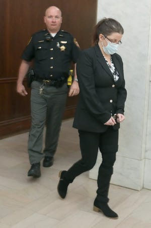 Cher Wagner is escorted from the courtroom Friday at the Summit County Courthouse in Akron after being found guilty in the June 30 stabbing death of Kelly Avery.