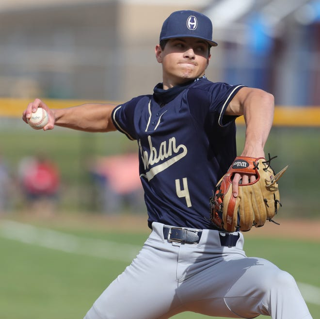Hoban starter Dylan Snyder pitches against Revere in a Division II district final. The Knights will take on Chagrin Falls in a regional semifinal Thursday at GlenOak Middle School. [Phil Masturzo/ Beacon Journal]