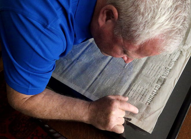 Medina Historical Society President Brian Feron reads the Gettysburg Address in an 1863 copy of the New York Tribune that was found in the McDowell-Phillips House in Medina.