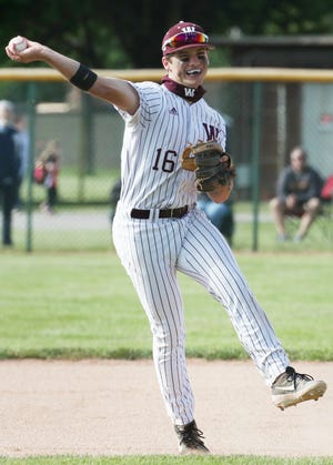 Walsh Jesuit Henry Kaczmar throw to first for the out after fielding a ground ball  against Dover in the fourth inning of the Division I baseball district final at Euclid High School on Thursday May 27, 2021 in Euclid, Ohio. Walsh beat Dover 3 to 1.