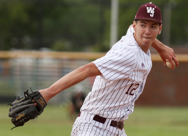 Walsh Jesuit's Erik Stern delivers a pitch against Dover in the sixth inning of a Division I baseball district final at Euclid High School on Thursday, May 27, 2021 in Euclid, Ohio. Walsh beat Dover 3-1. [Mike Cardew/Akron Beacon Journal]