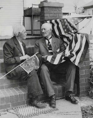 Former Confederate soldier John H. Massie chats with Union veteran Frank G. Stipe on May 30, 1934, before attending Memorial Day events in Akron. They are seated on the porch of Massie's home on Waverly Place in Cuyahoga Falls.