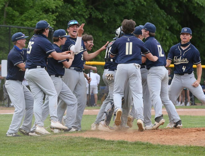 Hoban celebrates their 2-1 victory over Revere in a Division II District Final on Thursday, May 27, 2021 in Bath Township, Ohio, at Revere High School.  [Phil Masturzo/ Beacon Journal]