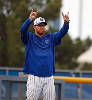 Nazareth coach Steven Moore calls a play to his team during the game against Westbrook, May 27, 2021, in Wolfforth, Texas.
