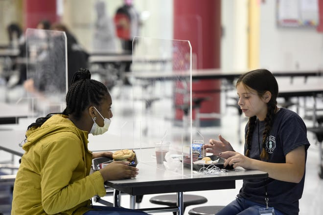 A photo from October 2020 shows students at Grovetown Middle School eating lunch while separated by clear dividers so they could socialize and eat without a mask. On Friday, Gov. Brian Kemp signed an executive order prohibiting schools from requiring students or employees to wear masks.