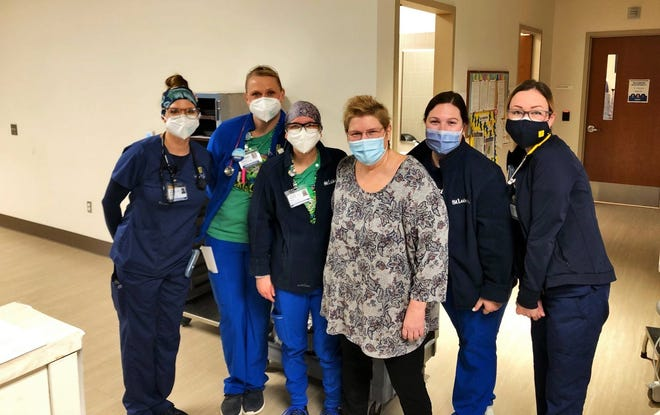 Michele Grida's caregivers at St. Luke's Upper Bucks Campus celebrated her survival during her in-person visit to the hospital to thank medical staff of the ICU and third floor. The five register nurses who cared for her are, from left, Brenda Costello; Melissa Juchno; Paige Lieberman; Michele Grida; Megan Maskornick; and Sharon Michael Rogers.