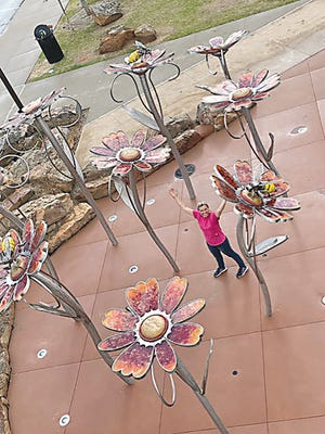 """Kansas City artist Amie J. Jacobsen stands within her creation """"Native Colors"""" in Bartlesville's Unity Square.  She will speak to the community at 5 p.m. June 4 as part of the art installation's official opening."""