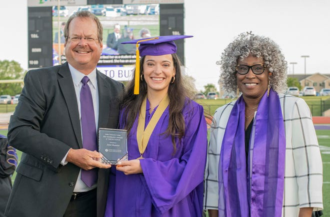 Board of Trustees Member, Rod Young (left) and 2021 Distinguished Alumna recipient, Junetta French Everett (right), presented Janet Busenitz (center) the Hubbard Award of Excellence at the May 14, 2021 Commencement Ceremony.