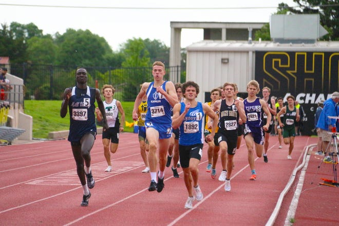 Andover's Sam McDavitt (1892) races down the home stretch of the boys' 800-meter finals on Thursday, May 27 in the Class 5A state track meet at Wichita State.