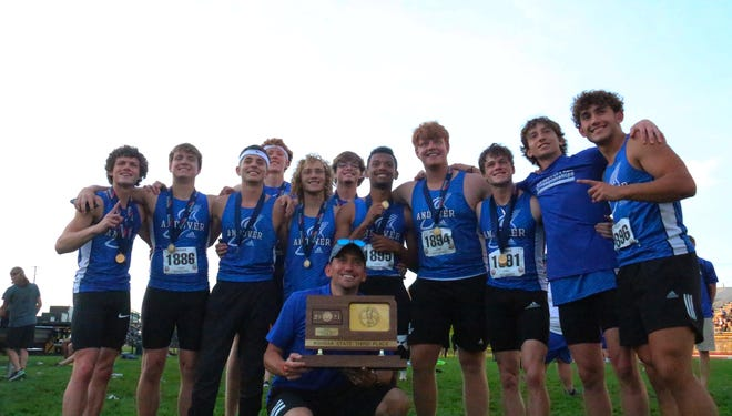 Andover track poses with their third place trophy on Thursday, May 27 at Wichita State University's Cessna Stadium
