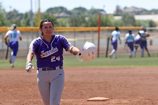 Butler's Ari Cordova walks off the field dejected while Florida Southwestern State celebrates Beth Reid's highlight catch during the sixth inning of Thursday's semifinal at the NJCAA National Tournament.