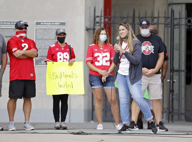 Amanda Babb, step-mother of Ohio State football player Kamryn Babb and president of Ohio State Football Parents Association, speaks to fans during a rally organized by parents of OSU football players outside of Ohio Stadium on Aug. 29, 2020.