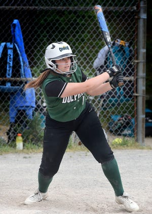 Becca Linn of Dennis-Yarmouth gets hold of a Sandwich pitch for a two-run triple on Friday.