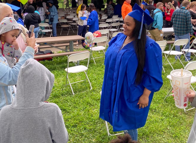 Alexis Cress poses for photos Friday after graduating from the Columbia Goodwill Excel Center.
