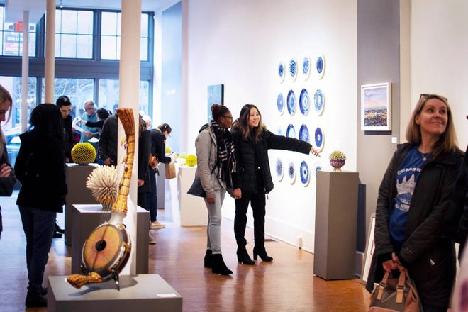 Visitors inside Sherrie Gallerie during a Gallery Hop in 2019