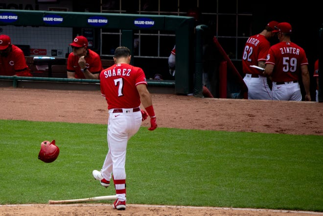 Cincinnati Reds infielder Eugenio Suarez, here kicking his helmet after striking out, is batting .160 after hitting .271 in 2019 and .202 in 2020.
