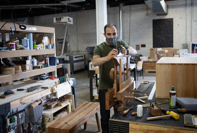 Woodworker Peter Augustinos, 30, of Downtown uses his grandfather's tools to build a saw vice from his rented workspace at the Idea Foundry in Franklinton.