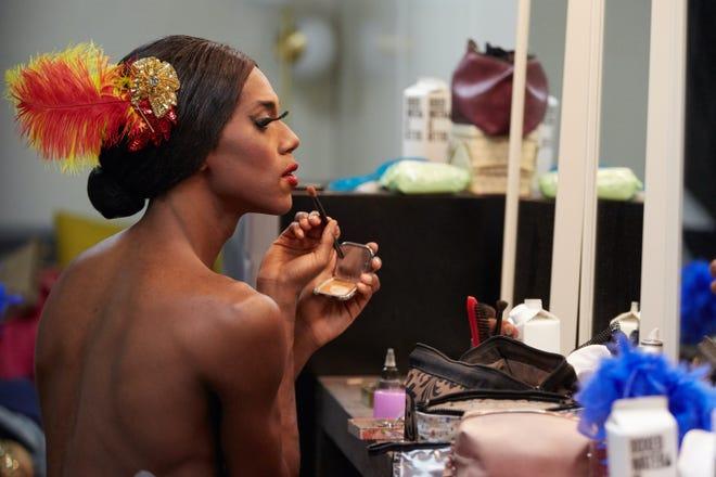 Trocks dancer Duane Gosa applies makeup backstage.