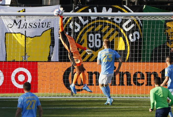 The Crew defense and goalkeeper Eloy Room, here making a save in front of Philadelphia Union forward Kacper Przybylko on April 18, haven't posted a shutout since May 1, though they have allowed the fourth-fewest goals with five.