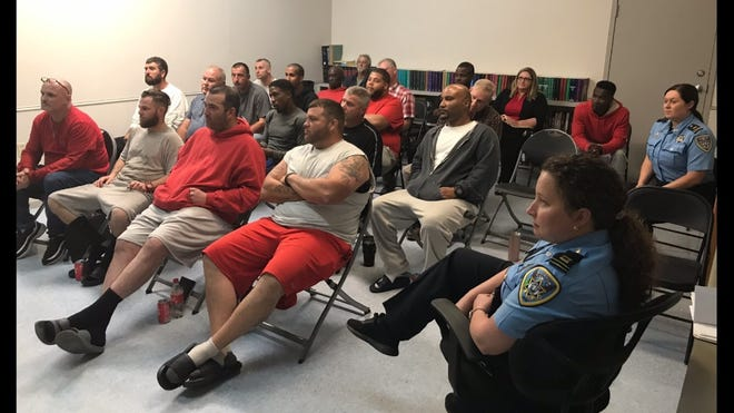 """Lafourche Parish jail inmates and deputies watch the documentary """"Unguarded"""" Thursday evening. The film is being screened in jails and prisons across the U.S."""