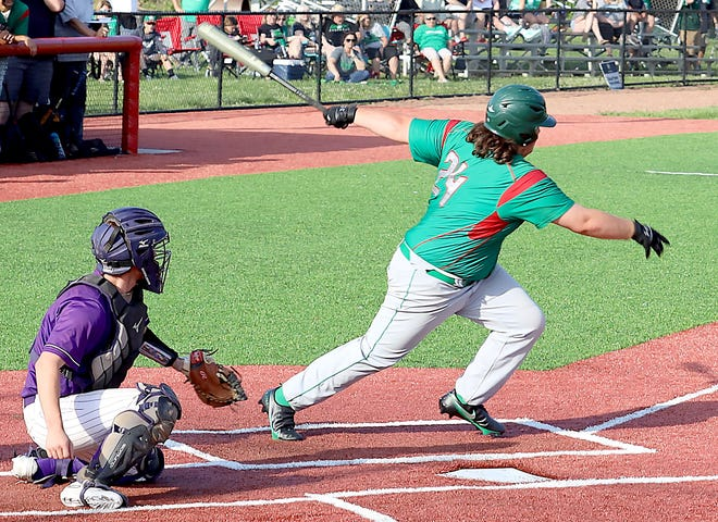 Barnesville's Gavin Carpenter connects for a hit during Thursday's Division III district championship game with Martins Ferry at Toronto High School.
