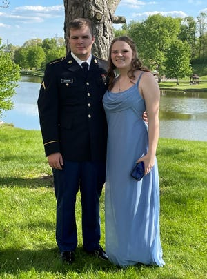Kacie Ramshaw recently graduated from Meadowbrook High School a year early despite severe anxiety during her time as a student at the Byesville area school. She credits her boyfriend, Jacob Addison, a member of the U.S. Army National Guard, with being one of the motivators for making the early graduation possible.
