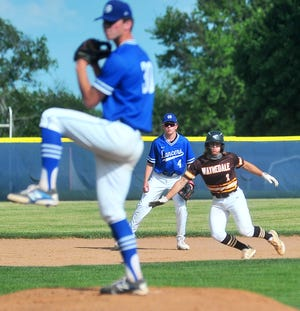 Waynedale's Jaden Varner (1) gets a lead as Gilmour Academy's Ben DeMell pitches.