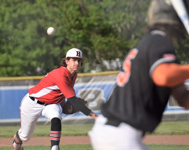 Hiland hurler Derrick Troyer delivers against Shadyside third baseman Nate Milhoon. Troyer combined with Nolan Yoder to shutout the Tigers and advance the Hawks to the Div. IV Regional tournament at Lancaster.