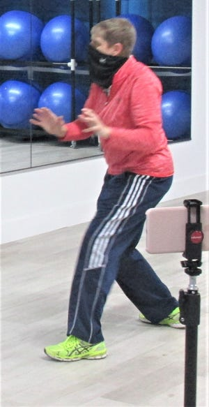 Cherly Seabright demonstrate some Tai Chi movements that will be taught at the free 11-week outdoor class beginning June 15 at the Holmes Park DIstrict Hipp Depot.