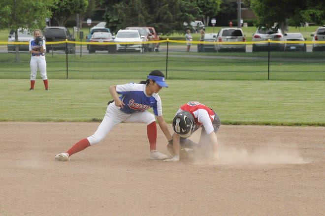 Britton Deerfield's Carlie Logan slides safely into second while Lenawee Christian's Yuki Nakamura goes to apply the tag during Thursday's doubleheader.