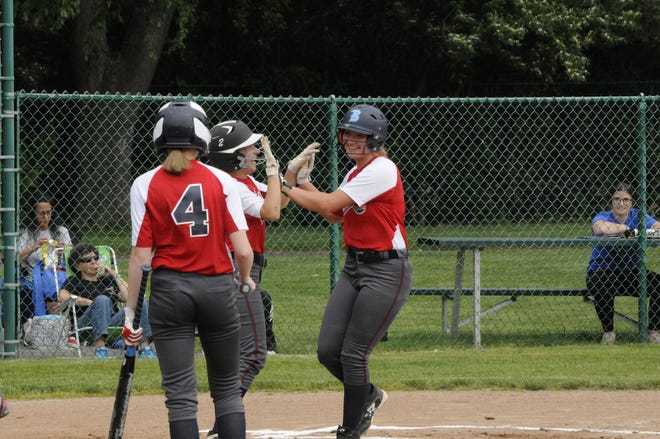 Britton Deerfield's Syd Hazlett is greeted by Carlie Logan and Kylie Spaulding (4) at home plate after hitting a home run during Thursday's doubleheader at Lenawee Christian.