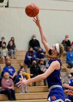 Lenawee Christian's Bree Salenbien goes up for a shot during a 2021 postseason game against Morenci.