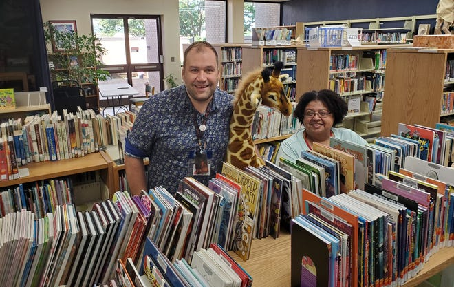Jason Roland and Carla Danzy, children's department employees at the Lexington branch of the Davidson County Public Library, are eager to welcome back library patrons for the first in-person program since the outbreak of COVID-19 in March 2020. The five branches of the library system will kick-off their Summer Reading programs from June 7-21 with offerings at all branches.