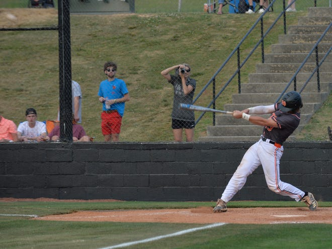 North Davidson's JR Lingerfelt smashes a two-run homer in the Black Knights' 8-4 win over Oak Grove. [Mike Duprez/The Dispatch]
