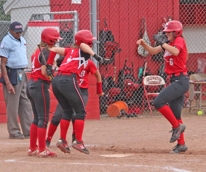 Coldwater's Jayla Foster (6) is greeted at home after her first inning home run Thursday versus Otsego.