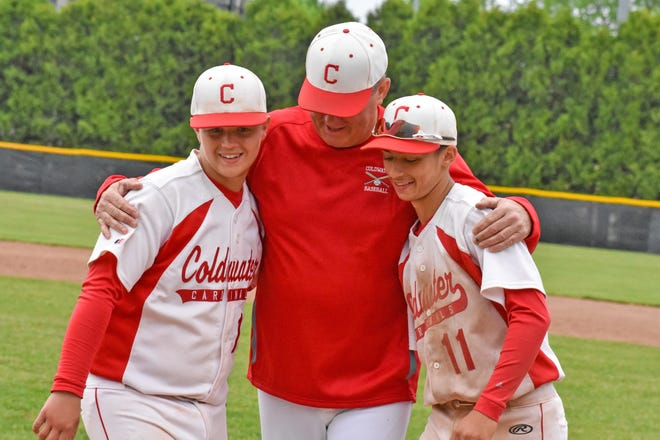 The Coldwater Cardinals celebrated their two seniors on Senior Night. Coach Randy Spangler is shown embracing his two seniors Cole Smith (left) and Brady McFarland (right).