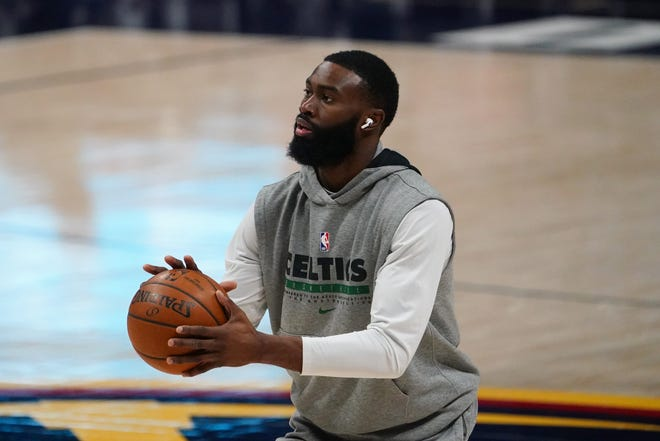 Apr 11, 2021; Denver, Colorado, USA;  Boston Celtics guard Jaylen Brown (7) warms up before the game against the Denver Nuggets at Ball Arena.