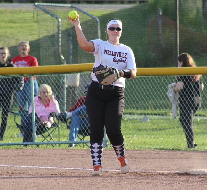 Wellsville first baseman Lauren Cicirello makes a throw during Thursday night's win over Allegany-Limestone.