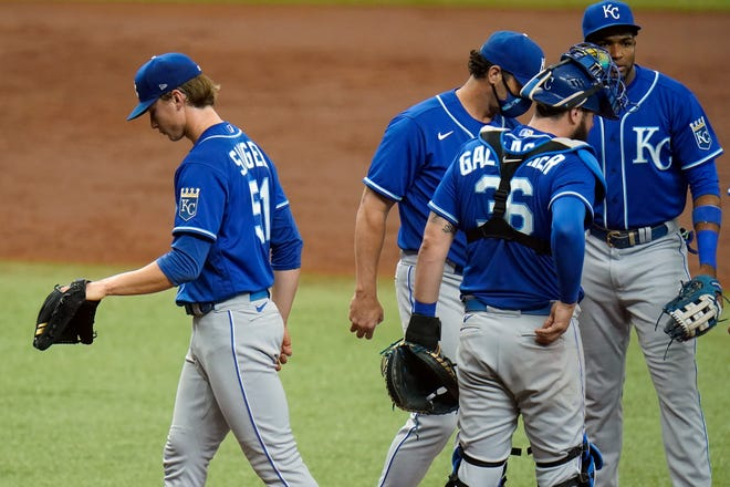 Kansas City Royals starting pitcher Brady Singer (51) walks off the mound after being taken out of the game by Royals manager Mike Matheny in the third inning of Thursday's game against the Tampa Bay Rays. Singer allowed six runs in 2 2/3 innings in the 7-2 loss.