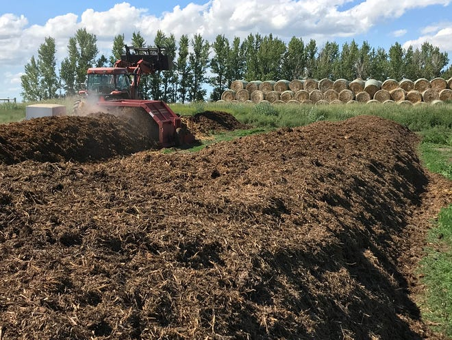 Turning compost is an essential step for maintaining proper temperature during the decomposition process.