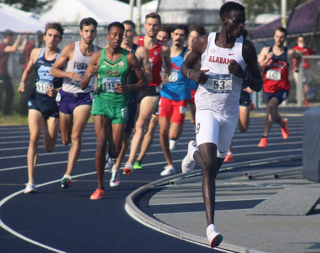 Alabama's Eliud Kipsang leads the field during a quarterfinal of the men's 1,500-meter run at the NCAA East Preliminary track and field championships. Kipsang went on to set a record for the UNF track.