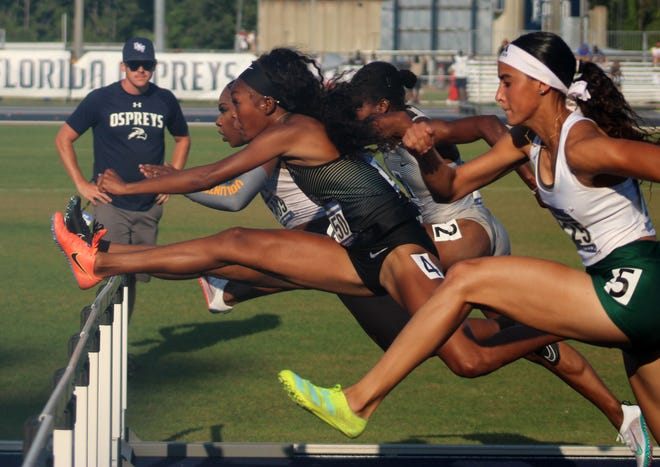 (From left) Alexis Duncan of Tennessee, Rayniah Jones of UCF, Madeleine Akobund of North Carolina A&T and Shaneylix Davila of South Florida lead runners over the women's 100-meter hurdles at the NCAA East Preliminary track and field championships.