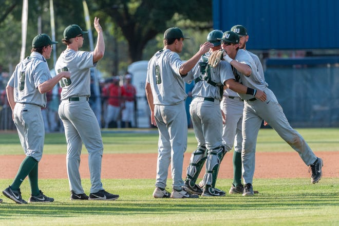 JU players celebrate their win over UNF as the Jacksonville University Dolphins downed the University of North Florida Ospreys by a score of 8-5 in the ASUN Conference baseball championship played at UNF's Harmon Stadium on Friday afternoon.Picture made May 28, 2021.Fran Ruchalski for the Atlantic Sun Conference