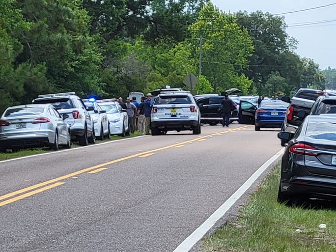 A large police presence gathers at Jones Road and Garden Street for an officer-involved shooting Friday in Jacksonville.