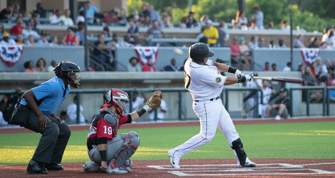 Gastonia Honey Hunters catcher Ermindo Escobar takes a swing during his team's season opener against the Lancaster Barnstormers.