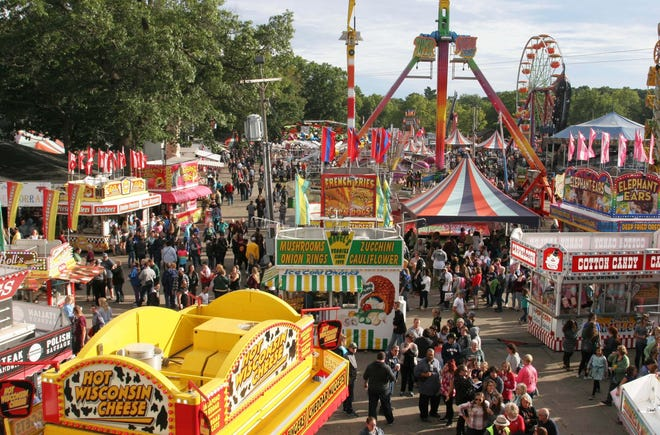 Food stands and carnival rides operate at the Allegan County Fair. Like most summer events, the fair was canceled in 2020 amid the COVID-19 pandemic. It will return this year.