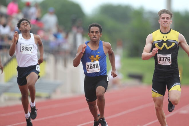 Hutchinson's Ezekiel Seamster competes in the 100-meter dash at the Kansas state high school track and field meet at Wichita State's Cessna Stadium Thursday, May 28, 2021.