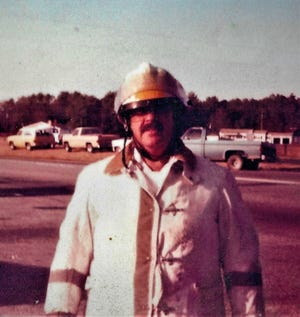 A young George Smith Jr. in his turnout gear.